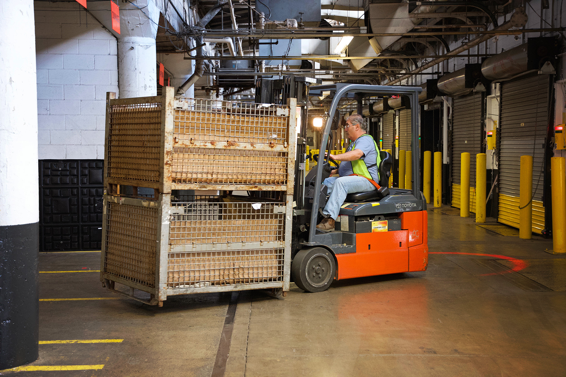 man operating fork lift in warehouse