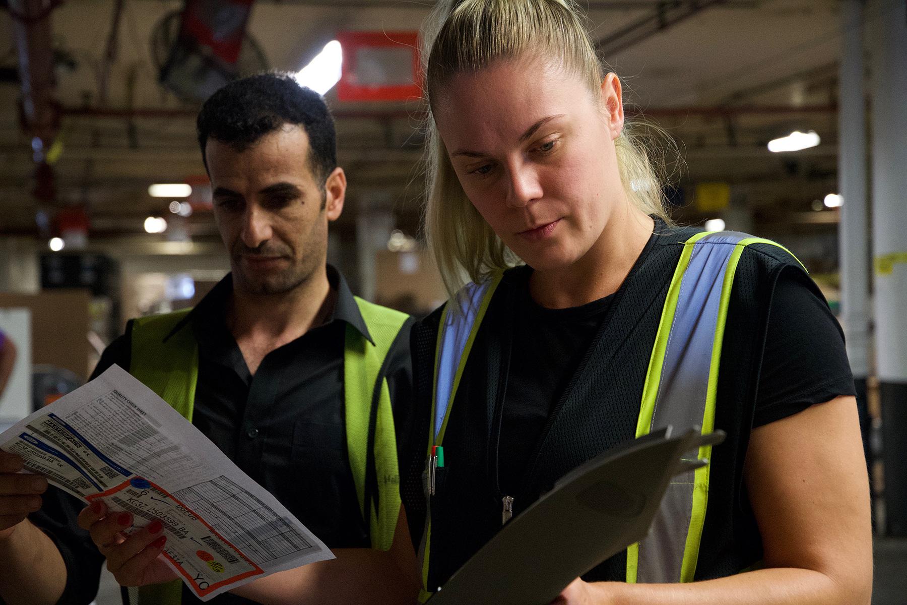 woman checking warehouse parts