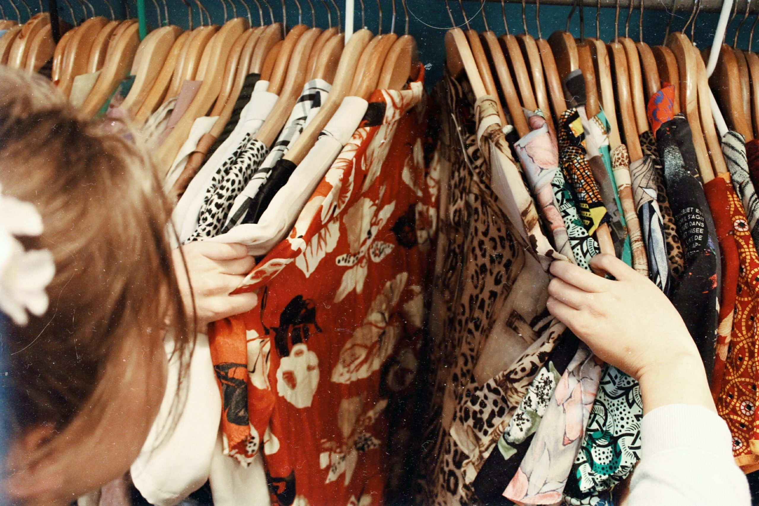 girl-shopping-in-racks-of-clothes