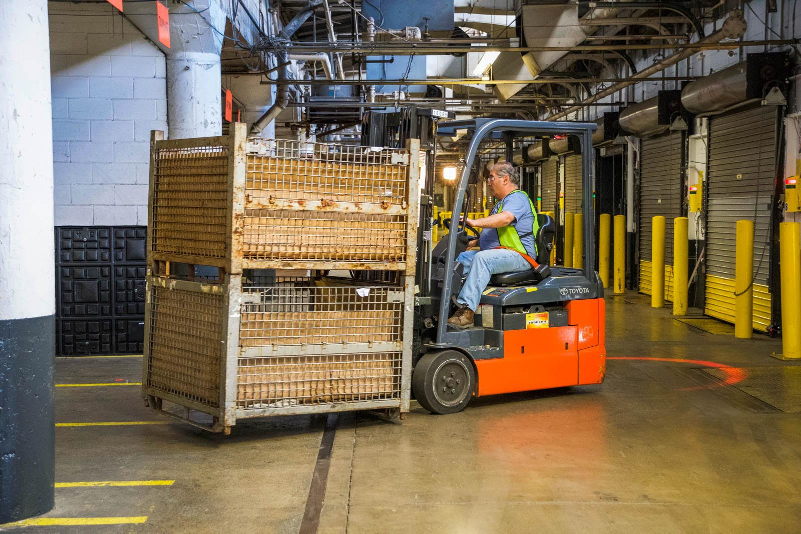 hollingsworth warehouse employee moving product with forkliftx